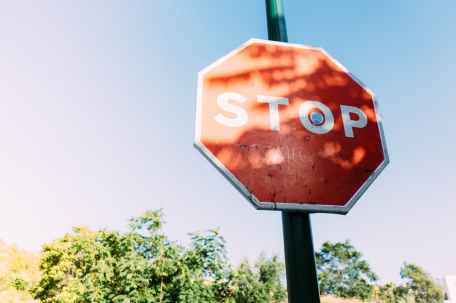 red stop signage under clear blue sky
