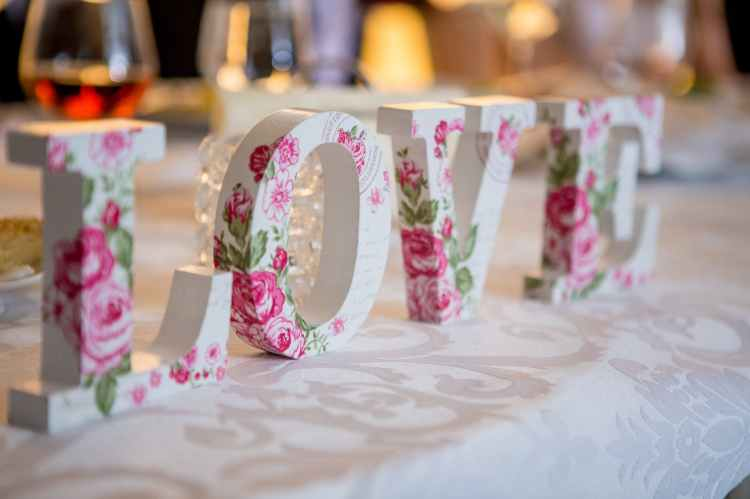 white and pink floral freestanding letter decor